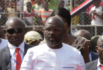 Liberia's President George Weah arrives for his swearing-in ceremony at the Samuel Kanyon Doe Sports Complex in Monrovia