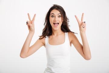 Portrait of a joyful girl dressed in tank-top
