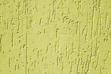 Grugy cement wall texture in yellow color.
