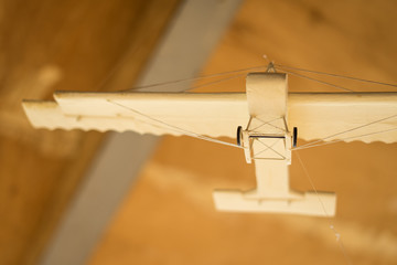 wooden figure of an airplane on the background of a table