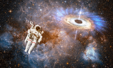Wall Mural - Astronaut in outer space against colorful storm galaxy. (Elements of this image furnished by NASA)
