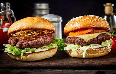 Tasty fresh meat burgers on wooden board