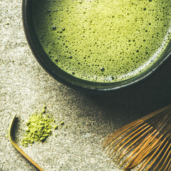Flat-lay of freshly brewed Japanese matcha tea in Chasen bowl, top view, square crop