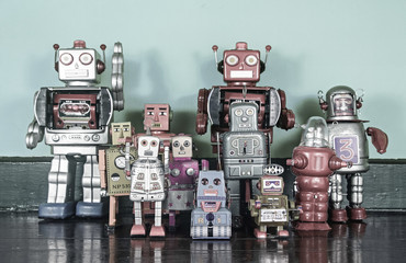 a team of retro robots on a wooden floor