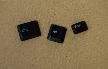 Isolated black keys of a keyboard: Ctrl + Alt +Supr. Shortcut in computing, concept of restore or restart during locks, with place for add text or elements.