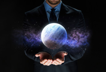 close up of businessman with planet hologram