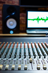 audio mixing console in recording, broadcasting studio. shallow dept of field, focus on knob