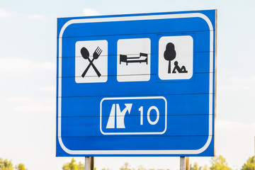 Dutch highway exit sign with tourist directions