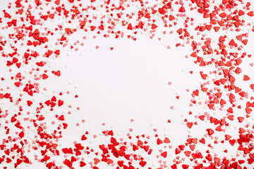Valentine's Day background. Frame of red, pink and white hearts. Flat lay, top view love concept.