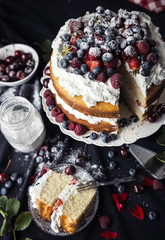 Beautiful, fruit naked cake on a dark tablecloth