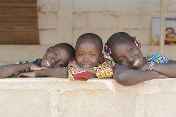 Three Adorable African Children Posing Outdoors Copy Space