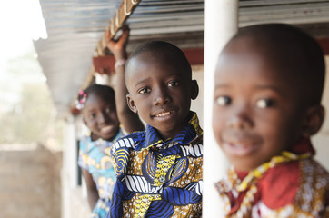 Three African Children Smiling and Laughing outdoors