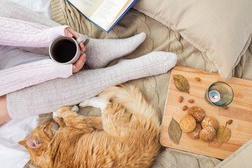 Fototapete - woman with coffee and red cat sleeping in bed