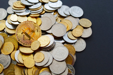 Picture of gold bitcoin over golden money. Digital money concept.