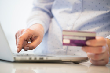 Close Up Of Woman Using Credit Card To Make Purchase On Laptop