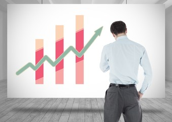 Businessman standing with colorful chart statistics on