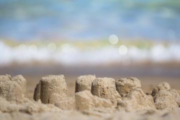 A sandcastle on a sandy beach