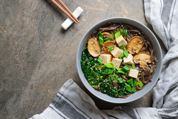 Vegetarian soup with kale mushrooms and soba noodle