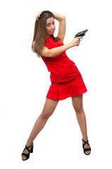 The spy. Special agent girl. Secret service. Dangerous sexy woman in short red dress in stockings and high heels shoes is holding gun in her hands isolated on white.