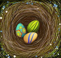 Three colored Easter s eggs in the nest with hay, decorated with blue and white flowers, Easter composition,