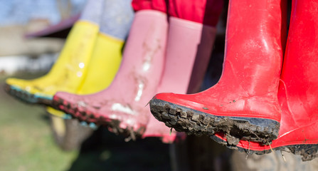 Three girls in dirty gumboots
