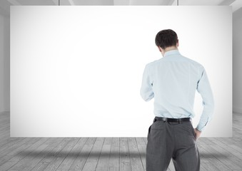 Businessman standing with whiteboard