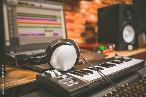 computer music home studio equipment headphone on midi keyboard synthesizer with laptop. Black Bedroom Furniture Sets. Home Design Ideas