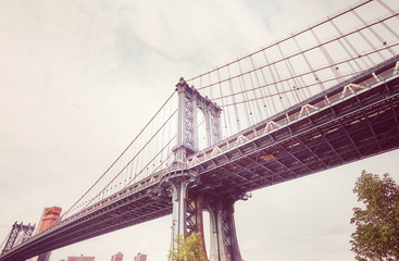 Retro stylized picture of the Manhattan Bridge seen from Brooklyn Dumbo, New York City, USA.