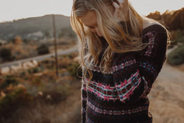 Woman in Sweater in Canyon with Golden Hour Light