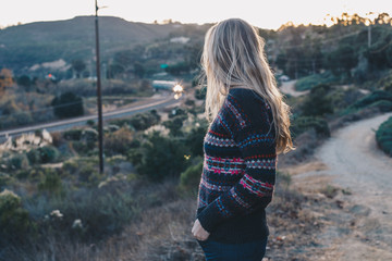 Woman in Sweater in Canyon with Train in Backgroung