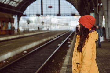 Fototapeta woman wiating for train on railway station obraz