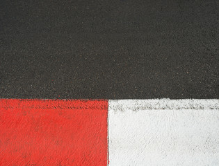 Texture of motor race asphalt and curb Grand Prix circuit