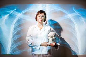 Portrait of a senior woman doctor in uniform with projected x-ray of human lungs