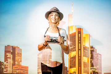 Fototapete - Portrait of a young woman traveler with projected image of skyscrapers in Frankfurt city