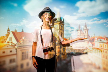 Portrait of a young woman traveler with projected image of cityscape view on Prague city
