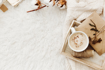Winter cozy background with cup of coffee, warm sweater and old letters. Flat lay for bloggers