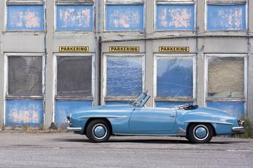 Blue Car in front of Parking in Copenhagen Denmark