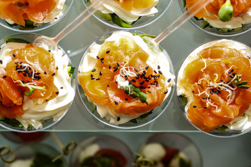Canape with rye bread cream cheese salmon and greens for christmas close up