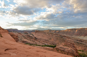 cliffs of Salt Valley at sunrise panoramic view from Delicate Arch