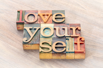 love yourself word abstract in wood type