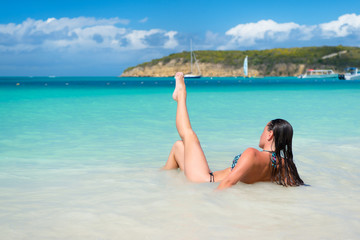 Young pretty woman with beautiful body in swimsuit, antigua