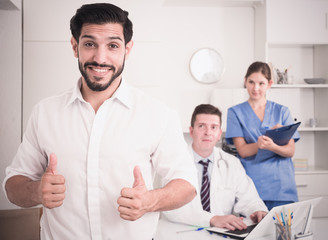 Satisfied male patient in medical office