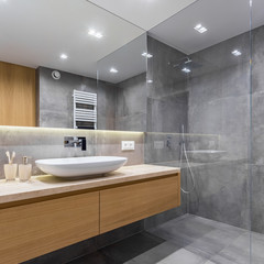 Gray bathroom with long countertop