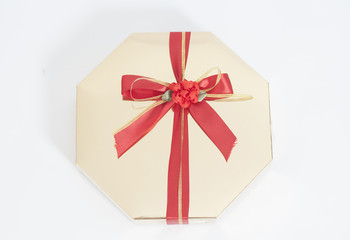 Gold Gift Box with candies and ribbon bow