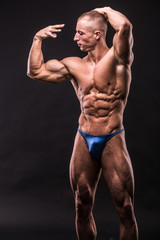 young bodybuider posing