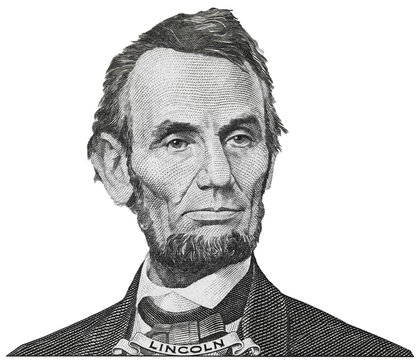 President Abraham Abe Lincoln face portrait on 5 dollar bill isolated, five usd, US money closeup