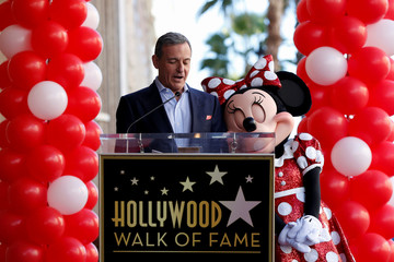 Chairman and CEO of The Walt Disney Company Iger speaks next to the character of Minnie Mouse at the unveiling of her star on the Hollywood Walk of Fame in Los Angeles
