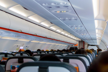 Interior of airplane with passengers on seats waiting to take off