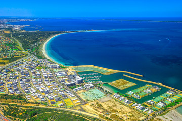 Aerial view of Fremantle Harbour, the Western Australia's largest and busiest general cargo port. Scenic flight over Fishing Boat Harbour, near Perth in Australia.