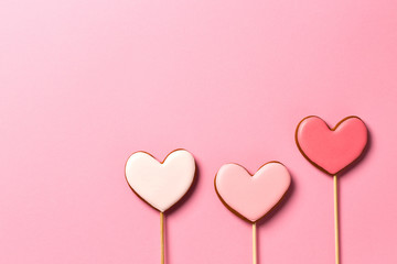 Gingerbread hearts isolated on pink background